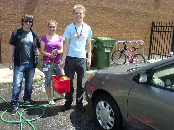 Rolf (right), and Convergys colleagues run car-wash fundraiser for Heron Park Playstucture Fund.