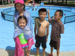 Michaela and her cousins Viviane, Coby and Kevin enjoy opening day of the Heron Park Wading Pool.